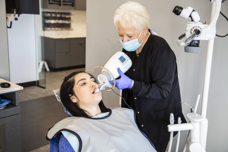 dental assistant works on a patient