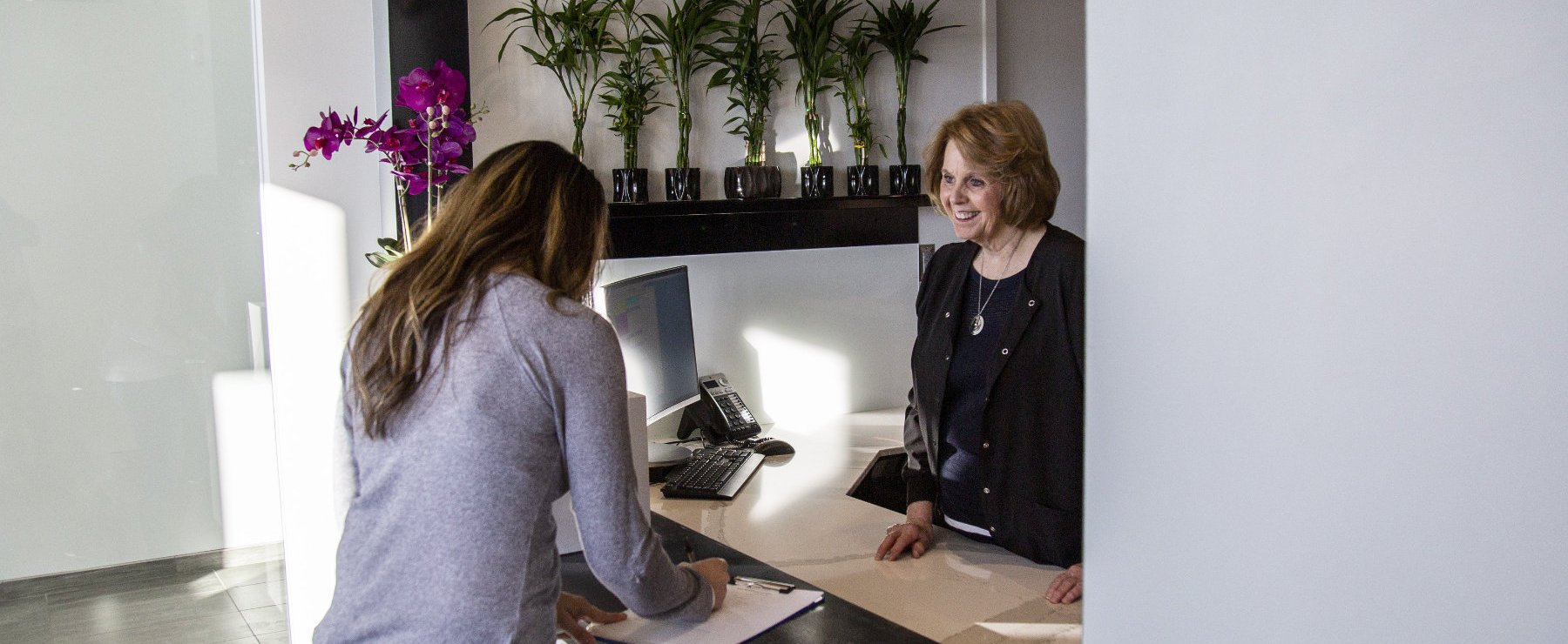 receptionist with patient